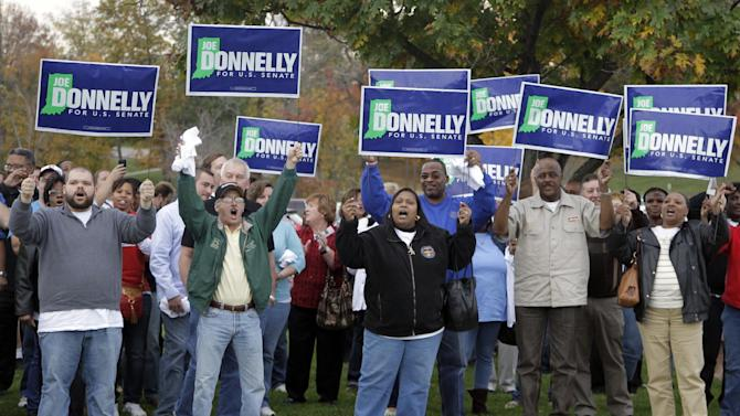 Supporters for Democrat Joe Donnelly, candidate for Indiana's U.S. Senate seat, cheer outside the site of a debate between Donnelly, Republican Richard Mourdock and Libertarian Andrew Horning in New Albany, Ind., Tuesday, Oct. 23, 2012. (AP Photo/Michael Conroy