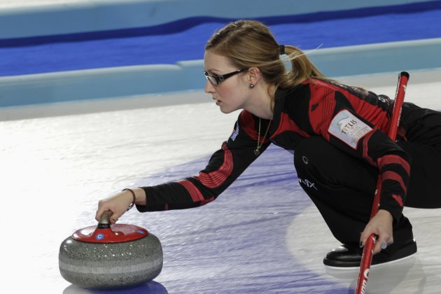 Canada's second Kreviazuk delivers stone during World Women's Curling Championship qualification round match against Japan in Riga