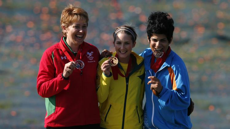 Wales' Allen, Australia's Coles and Cyprus' Eleftheriou celebrate with their medals which they won in the women's skeet final at Barry Buddon shooting centre at the 2014 Commonwealth Games in Glasgow, Scotland