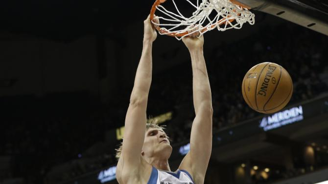 Minnesota Timberwolves' Andrei Kirilenko, center, of Russia, dunks as Oklahoma City Thunder's Kevin Durant, left, and Serge Ibaka, right, of Congo, watch during the first quarter of an NBA basketball game, Friday, March 29, 2013, in Minneapolis. (AP Photo/Jim Mone)