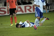 Finland&#39;s Joona Toivio lies on the ground between Luuk de Jong, left, of the Netherlands and Mika Vyrynen of Finland during the UEFA Euro 2012 Group E qualifying soccer match Finland vs the Netherlands at the Olympic Stadium in Helsinki, Finland, on Tuesday Sept. 6, 2011. (AP Photo/LEHTIKUVA, Jussie Helttunen) FINLAND OUT - NO SALES