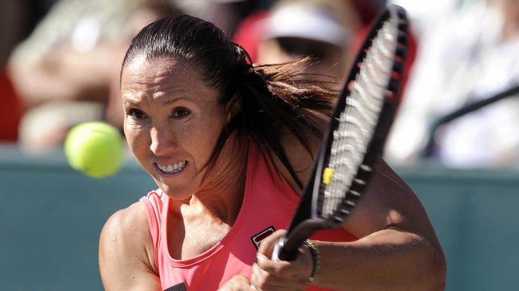 Jelena Jankovic of Serbia, hits a backhand shot during a semifinal match against Stefanie Voegele of Switzerland, at the Family Circle Cup tennis tournament in Charleston, S.C., Saturday, April 6, 2013. Jankovic won 6-4, 6-7 (6), 6-2. (AP Photo/Stephen Morton)