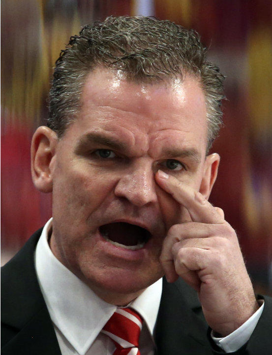 Switzerland's head coach Sean Simpson gestures during their 2013 IIHF Ice Hockey World Championship final match against Sweden at the Globe Arena in Stockholm