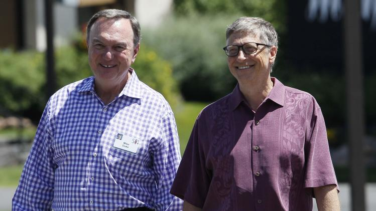 Microsoft technology advisor Gates walks with former Walmart CEO Duke during the second day of the Allen and Co. media conference in Sun Valley, Idaho