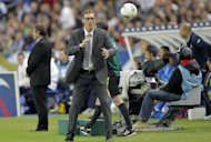 France's coach Laurent Blanc catches the ball during a Euro 2012 Group D qualifying soccer match France against Bosnia, at Stade de France stadium in Saint Denis, near Paris, Tuesday, Oct. 11, 2011.(AP Photo/Jacques Brinon)