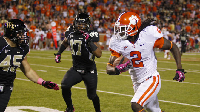 Clemson's Sammy Watkins (2) runs past Wake Forest's Riley Haynes (45) and A.J. Marshall (17) during the first half of an NCAA college football game in Winston-Salem, N.C., Thursday, Oct. 25, 2012. (AP Photo/Chuck Burton)