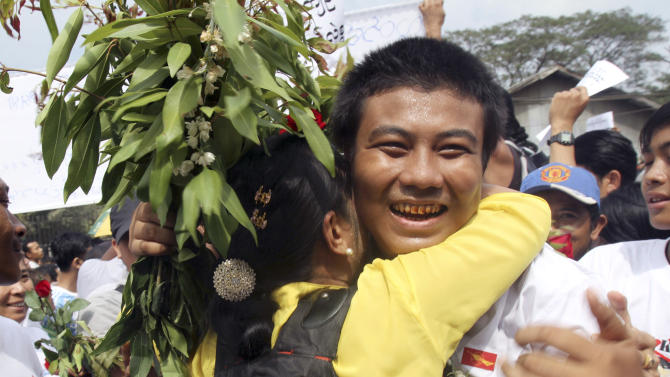 In this photo taken on Jan. 13, 2012, a freed Myanmar political prisoner, right, is welcomed by his friend as he comes out of Insein prison in Yangon, Myanmar. Myanmar's government said Monday, Sept. 17, 2012 it has granted amnesties for 514 prisoners, including some foreigners, on humanitarian grounds. (AP Photo/Khin Maung Win)