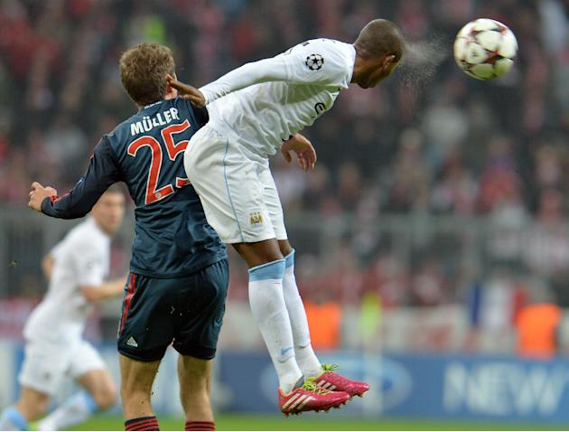 Bayern's Thomas Mueller, left, and Manchester City's Fernandinho, right, challenge for the ball during the Champions League group D soccer match between FC Bayern Munich and Manchester City, i