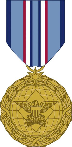 This image released by the Department of Defense shows the obverse view with ribbon of the newly announced Distinguished Warefare Medal. The Pentagon created the new medal that can be awarded to troops who have a direct impact on combat operations but do it from afar. The new medal for cyber warriors should get a demotion, according to veterans groups and lawmakers who say it shouldn't outrank such revered honors as the Bronze Star and the Purple Heart. (AP Photo/Department of Defense)