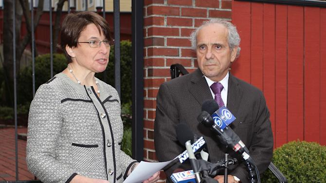 Miriam Weizenbaum, left and Amato DeLuca, right, attorneys for Katherine Tsarnaeva, widow of Boston Marathon bomber suspect Tamerlan Tsarnaev, issue a statement on her behalf, Tuesday, April 23, 2013, Providence, R.I.  The attorneys said Tsnarnaeva is deeply mourning the bombing victims. They say that Tsarnaeva and her family were in shock when they learned of allegations against her husband and brother-in-law, Dzhokhar Tsarnaev.  (AP Photo/Stew Milne)