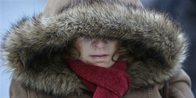 A Commuter bundles up against extreme cold conditions Tuesday, Jan. 22, 2013, in Chicago. Temperatures in the area were hovering around zero with sub-zero wind chill reading hitting 10 below. Forecast