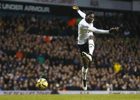 Emmanuel Adebayor of Tottenham Hotspur has a shot at goal against Sunderland during their English Premier League soccer match at White Hart Lane, London