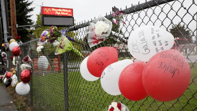 A makeshift is seen outside Marysville-Pilchuck High School the day after a school shooting in Marysville