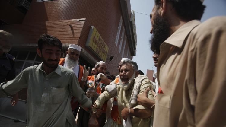 Man cries over death of his relative, who was killed in a bomb blast, at a hospital in Peshawar
