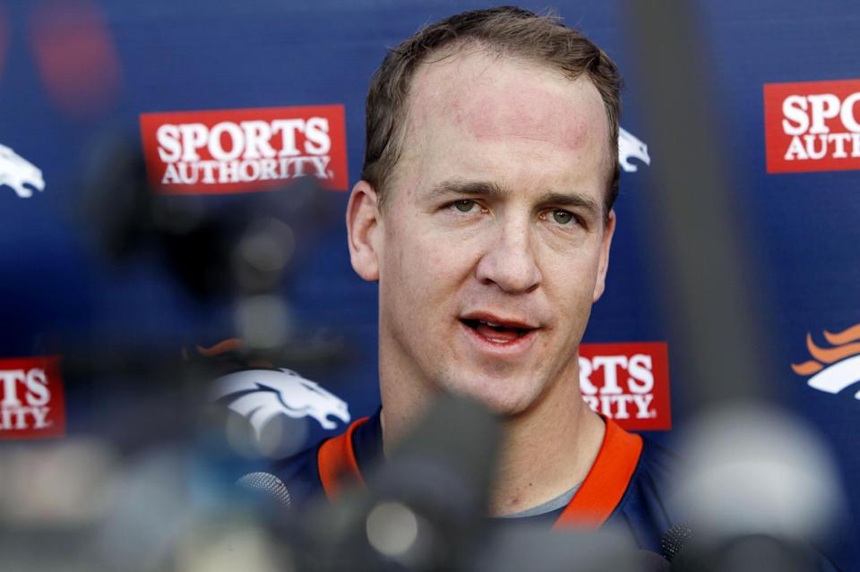 Denver Broncos quarterback Peyton Manning addresses the media after taking part in his first mini camp since joining the team at Broncos headquarters in Englewood, Colo., on Monday, May 21, 2012. (AP Photo/David Zalubowski)