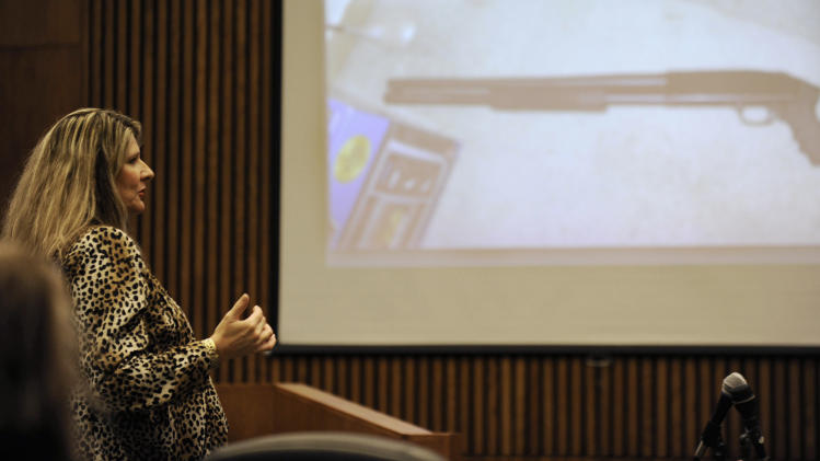 Wayne County Assistant Prosecutor Danielle Hagaman-Clark talks while a photo of the shotgun that was used to kill Renisha McBride is displayed, during Theodore Wafer's second-degree murder trial, Wednesday, July 23, 2014, in Detroit. (AP Photo/The Detroit News, David Coates)