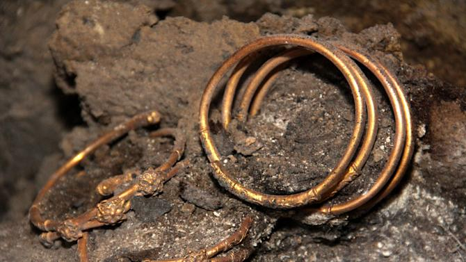 Artifacts, part of  2,400-year old golden hoard found in an ancient Thracian tomb in northern Bulgarian village of Sveshtari, some 400 kilometer (250 miles) northeast of Sofia,are seen on Thursday, Nov 8, 2012.  Prof. Diana Gergova , archeologist and team leader said that among the artifacts, which date  back to the end of the fourth or the beginning of the third century B.C., were gold jewelry and applications for horse  trappings, a tiara with reliefs of lions and fantasy animals, as well as four bracelets and a ring.  (AP Photo/ImpactPressGroup)