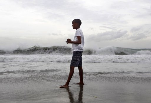 <p>A boy watches the high waves caused by Storm Ernesto along the south coast in Santo Domingo on August 4. Jamaica buckled down Sunday as Tropical Storm Ernesto barreled past it toward Belize and Mexico's Yucatan Peninsula, US forecasters said.</p>