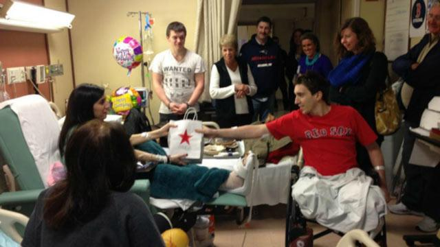 Jeff Bauman Gives Present to Fellow Boston Bombing Victim