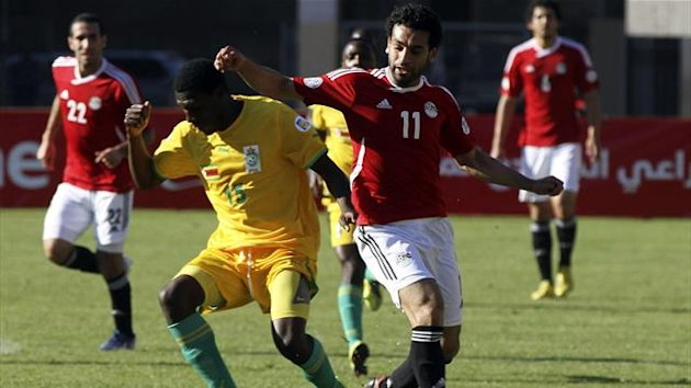 Zimbabwe's Lincoln Zvasiya (L) fights for the ball wih Egypt's Mohamed Salah during their 2014 World Cup qualifying soccer match at the National Sports Stadium in Harare June 9, 2013. REUTERS