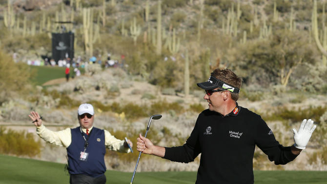 Ian Poulter calls for an official after a disturbance from the crowd on the 16th green in the quarterfinal round of play against Steve Stricker during the Match Play Championship golf tournament, Saturday, Feb. 23, 2013, in Marana, Ariz. Poulter won 3 and 2. (AP Photo/Ross D. Franklin)