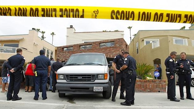 2012 NFL Police stand in front of the home of former San Diego Chargers linebacker Junior Seau as a coroners van waits to take his body away