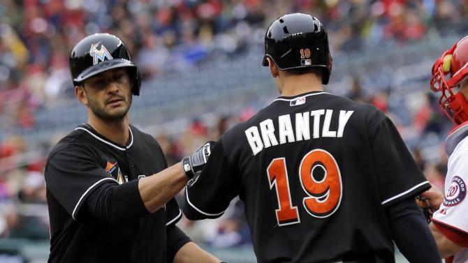 Miami Marlins' Justin Ruggiano, left, celebrates his solo home run with teammate Rob Brantly during the second inning of a baseball game against the Washington Nationals at Nationals Park, Thursday, April 4, 2013, in Washington. (AP Photo/Alex Brandon)