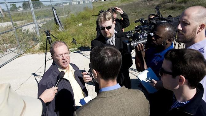 Moberly mayor Bob Riley talks to the media after Missouri Attorney General Chris Koster announced felony charges against former Mamtek U.S. CEO Bruce Cole outside the failed business in Moberly, Mo., Tuesday, Sept. 18, 2012.  The Mamtek U.S. property will be auctioned on October 24. (AP Photo/Columbia Daily Tribune, Kit Doyle)