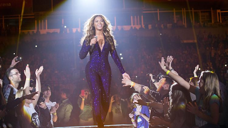 "Singer Beyonce performs on the opening night of her ""Mrs. Carter Show World Tour 2013"", on Monday, April 15, 2013 at the Kombank Arena in Belgrade, Serbia. Beyonce is wearing a cobalt blue hand beaded jumpsuit by designer Vrettos Vrettakos. (Photo by Yosra El-Essawy/Invision for Parkwood Entertainment/AP Images)"
