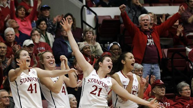 FILE - In this Jan. 27, 2013, file photo, Stanford's Bonnie Samuelson (41), Taylor Greenfield (4), Sara James (21) and Erica Payne (25) celebrate in the closing seconds of their 69-56 win over Colorado in an NCAA college basketball game in Stanford, Calif. Stanford was announced Monday, March 18, to join Connecticut, Notre Dame and Baylor as a No. 1 seed in the women's tournament, marking the second straight season those four schools were the top seeds. (AP Photo/Marcio Jose Sanchez, File)