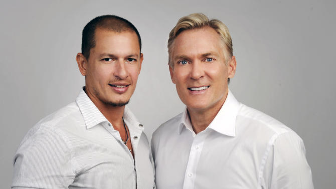 "This May 2012 photo released by ABC shows ""Good Morning America"" weatherman Sam Champion, right, with Rubem Robierb in New York. ABC News says Champion and Robierb are engaged to be married later this year. Champion tweeted Friday, Oct. 5, that he's ""never been happier"" to share a bit of personal news. Champion and Robierb met through mutual friends in Miami, where Robierb lives, according to ABC. Born in Brazil, Robierb is a fine-arts photographer who shows his work in Miami, Atlanta, Santa Monica and New York. (AP Photo/ABC, Ida Mae Astute)"