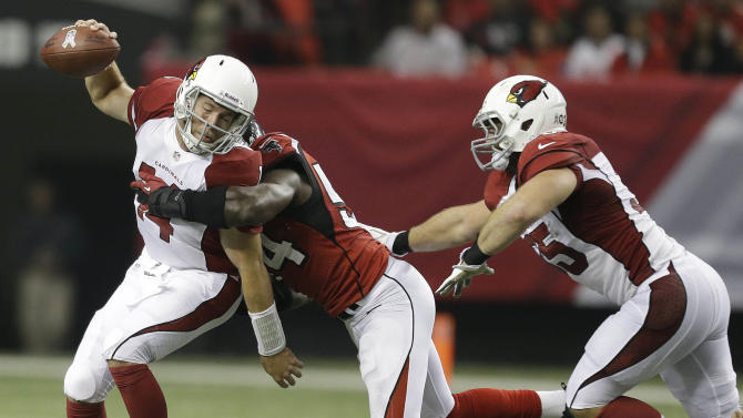 Atlanta Falcons outside linebacker Stephen Nicholas (54) tackles Arizona Cardinals quarterback Ryan Lindley (14) for a sack as Arizona Cardinals fullback Anthony Sherman (35) blocks during the second half of an NFL football game Sunday, Nov. 18, 2012, in Atlanta. (AP Photo/David Goldman)