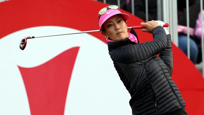 Michelle Wie of the U.S. tees off from the first hole during the first day of the Women's British Open golf championship on the Turnberry golf course in Turnberry, Scotland, Thursday, July 30, 2015. (AP Photo/Scott Heppell)