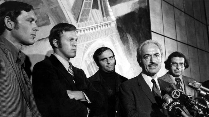 CORRECTS TITLE OF DICK MOSS TO GENERAL COUNSEL, NOT ASSISTANT  COUNSEL - FILE - This April 13, 1972 file photo shows Marvin Miller, executive director of the Major League Baseball Players Association, announcing an end to the baseball strike at a news conference in New York. Players shown are, from left,  Gary Peers of the Boston Red Sox, Wes Parker of the Los Angeles Dodgers, and Joe Torre of the St. Louis Cardinals.  At right is Dick Moss, general counsel  for the association. Miller, the union leader who created free agency for baseball players and revolutionized professional sports with multimillion dollar contracts, died Tuesday, Nov. 27, 2012 in New York. He was 95. (AP Photo/File)