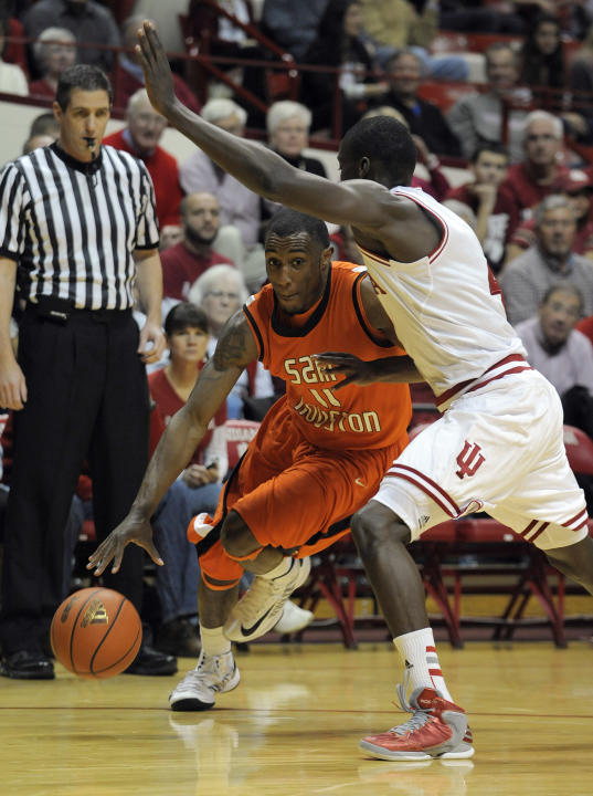 Sam Houston State guard Demarcus Gatlin, left, drives against Indiana guard Victor Oladipo during the first half of an NCAA college basketball game in Bloomington, Ind., Thursday, Nov. 15 2012. (AP Ph