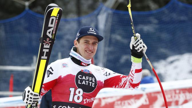 Mayer of Austria celebrates his second place  before the podium celebration after the men's World Cup Downhill skiing race in in Santa Caterina
