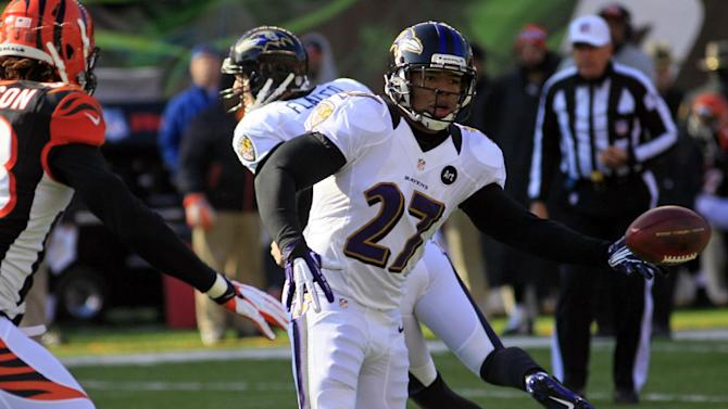 Baltimore Ravens running back Ray Rice (27) laterals the ball in the first half of an NFL football game against the Cincinnati Bengals, Sunday, Dec. 30, 2012, in Cincinnati. (AP Photo/Tom Uhlman)