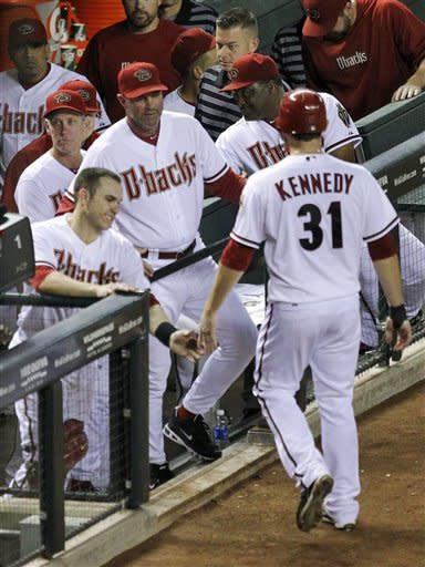 Kennedy has big hit, pitches D-backs to win