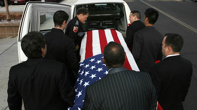 """Pallbearers carry Sherman Hemsley's remains into Cielo Vista Chuch in El Paso, Texas, Wednesday, Nov. 21, 2012, nearly four months after his death. Friends and family are remembering actor Sherman Hemsley at his funeral service in Texas by showing video clips of his best known role as George Jefferson on the TV sitcom """"The Jeffersons."""" He died in July but a fight over his estate has delayed his burial. (AP Photo/The El Paso Times, Mark Lambie)  EL DIARIO OUT; JUAREZ MEXICO OUT; AND EL DIARIO DE EL PASO OUT"""