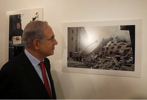 Israel's Prime Minister Benjamin Netanyahu attends an exhibition of photographs in Jerusalem