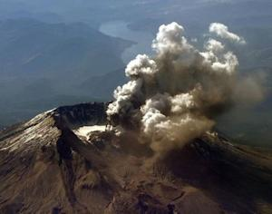 Aerial view of Mt St Helens as it spews steam and ash.