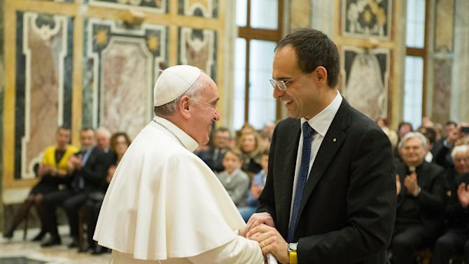 Pope Francis greets Roberto Moncalvo, president of the Coldiretti Italian farmers lobby, at the end of an audience he held at the Vatican, Saturday, Jan. 31, 2015. (AP Photo/L'Osservatore Romano, Pool)