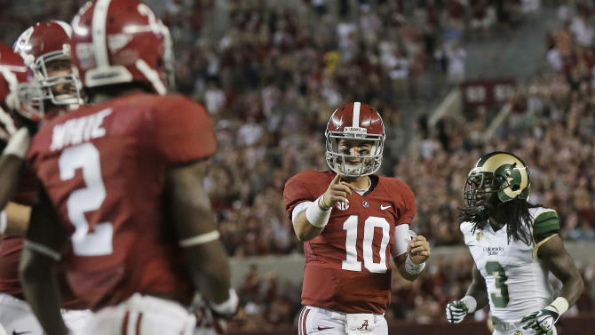 Alabama quarterback AJ McCarron (10) celebrates after throwing a 30-yard touchdown pass to wide receiver DeAndrew White (2) during the second half of an NCAA college football game in Tuscaloosa, Ala., Saturday, Sept. 21, 2013. At right is Colorado State cornerback Shaq Bell. Alabama won31-6. (AP Photo/Dave Martin)