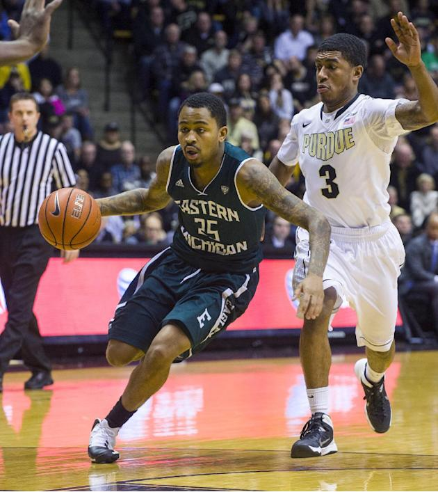 Eastern Michigan's Darell Combs (25) races past Purdue's Ronnie Johnson (3) in the first half of an NCAA college basketball game, Saturday, Dec. 7, 2013, in West Lafayette, Ind