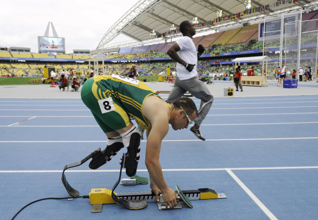 South Africa's Oscar Pistorius, front, prepares his starting blocks ahead of a heat of the Men's 400m at the World Athletics Championships in Daegu, South Korea, Sunday, Aug. 28, 2011. (AP Photo/Marti