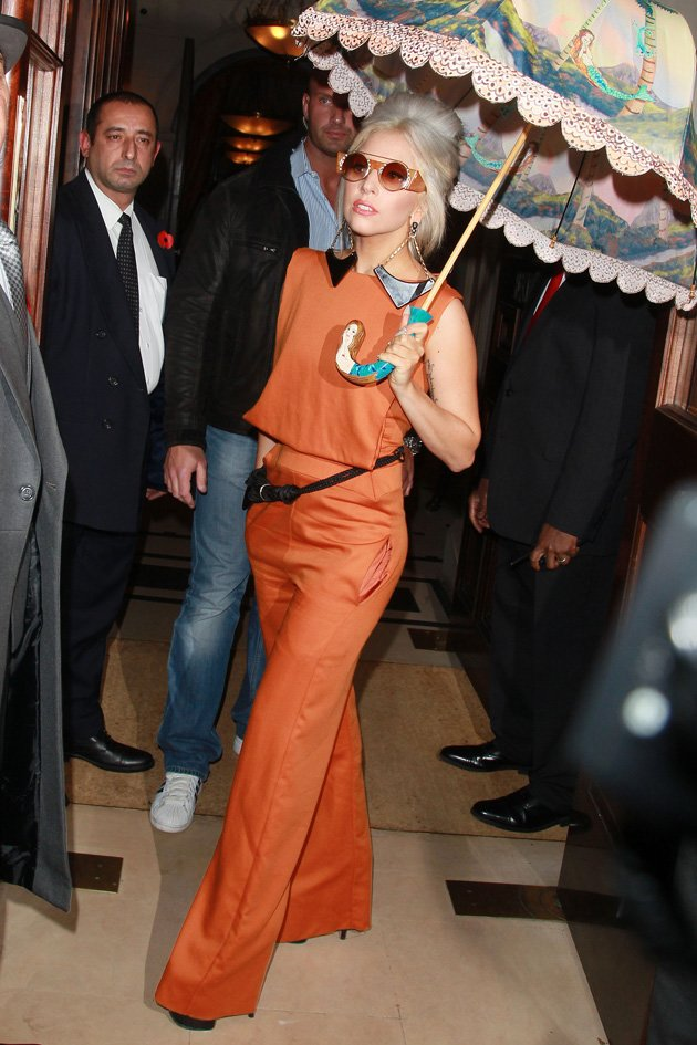 Gaga held a parasol as she …