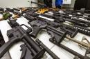 California governor signs stringent gun bills, vetoes others