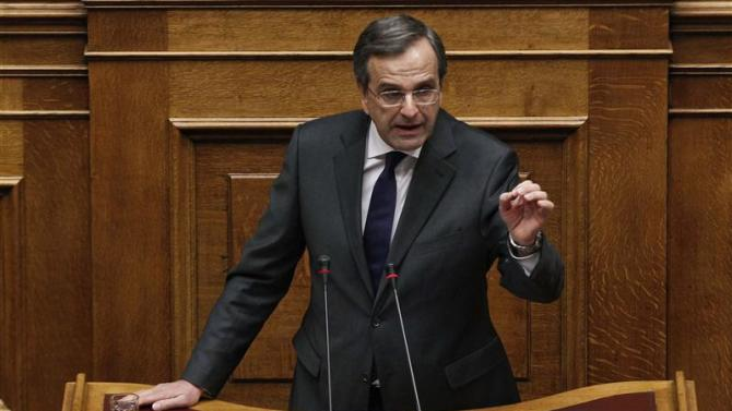 Greece's Prime Minister Samaras delivers a speech during a parliament session where lawmakers vote on the 2014 budget in Athens