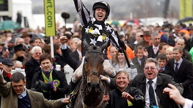 HORSE RACING Paddy Brennan on Imperial Commander celebrates as he enters unsaddling enclosure after winning Cheltenham Gold Cup