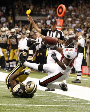 Tampa Bay Buccaneers wide receiver Preston Parker (87) drops  a pass as the official throws a flag against New Orleans Saints free safety Malcolm Jenkins (27) during the fourth quarter of an NFL football game in New Orleans, Sunday, Nov. 6, 2011. (AP Photo/Jonathan Bachman)